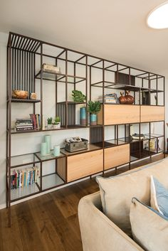 A minimalist design of iron books combined with transparent wood and glass with covert and visible storage for accessories and books in a living room. Office Interior Design, Interior Design Living Room, Sofa Design, Furniture Design, Muebles Living, Living Room Decor Inspiration, Bookshelf Design, Wall Shelves Design, Cool Curtains