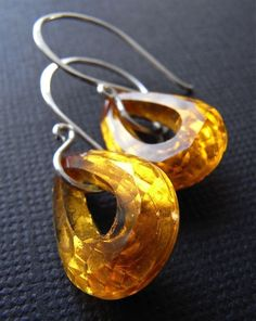 The Aine earrings - gorgeous vintage glass teardrops with a gold foil backing allows these beauties to sparkle like crazy! The amber/honey hue is simply dazzling. Finished with hand forged ear wires in sterling silver. Amber Earrings, Amber Jewelry, Jewelry Case, Metal Jewelry, Sterling Silver Earrings, Beaded Jewelry, Unique Jewelry, Handmade Jewelry, Jewelry Design