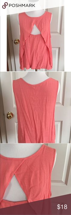 "NWOT Free People Sleeveless Swing Top Large NWOT Free People Coral swing top. Viscose and rayon blend. Lightweight swing top with overlay in front. Super cute!  Size Large  23"" across at bust  24"" long . Free People Tops"