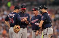 Minnesota Twins pitching coach Rick Anderson #40 talks with Nick Blackburn #52, Trevor Plouffe #24 and Joe Mauer #7 during the game gainst the Detroit Tigers at Comerica Park on July 3, 2012 in Detroit, Michigan
