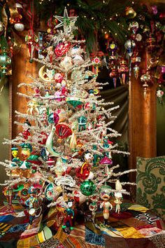 Vintage ornaments on a tinsel tree. - Now I want a tinsel tree. Merry Little Christmas, Noel Christmas, Vintage Christmas Ornaments, Winter Christmas, Christmas Decorations, Glass Ornaments, Whimsical Christmas, Tree Decorations, Christmas Skirt