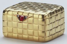 Fabergé engraved gold with diamonds and cabochon ruby. Produced prior to 1896 in the workshop of Fabergé's first head workmaster, Erik Kollin, this box is engraved to resemble basket weave. Presented to Queen Mary by the Nawab of Bahamalpour, before 1949.
