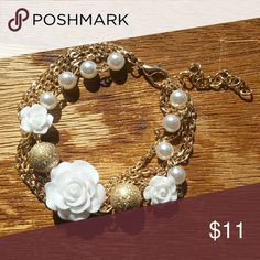 Pearls & Gold White Rose Bracelet NWOT Beautiful bracelet with white roses, faux pearls, and delicate gold chains.  9'' long total with small 2'' extender chain. Jewelry Bracelets