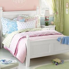 Love the pink, green, blue, lavender mix & match with white bed for a girls room.