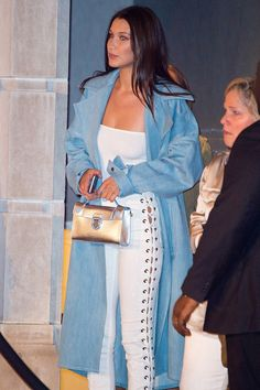Bella Hadid Wore Lace-Up Jeans, and Guess Which Supermodel's Got Them Too? Bella Hadid Wearing White Lace-Up Jeans Bella styled her denim with a white tube top, Rask NYC oversize trench, heeled sandals, and a metallic mini bag. Lace Up Leather Pants, Lace Pants, Bella Hadid Outfits, Bella Hadid Style, Sweat Shirt, Isabel Marant, Costume Noir, Spring Fashion Outfits, Black And White