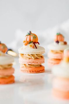 A new recipe for pumpkin spice latte french macaron stacks, topped with sprinkles and decorations from Wilton's autumn line!