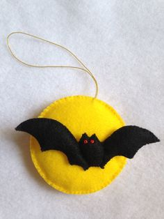 This handmade Halloween ornament is made from good quality felt and lightly stuffed with polyester filling. Each and every piece is carefully hand cut and hand stitched with love and care and comes from a smoke and pet free home.  The approximate measurements are, • Bat - height 1 1/2 length 4 • Moon - diameter 3 1/4 • Code - length 3 1/2  **Due to the nature of handmade, the stitching and placement on each piece may vary slightly.