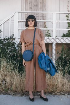 Simple blouse with coordinating draped trousers, circle cynlinder blue bag