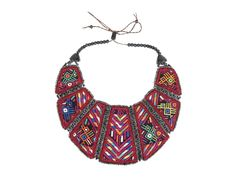 Make a statement with this beautiful handmade piece from Antigua Guatemala. Crafted from reclaimed fabric and ceramic beads, it features adjustable closure. Each necklace varies slightly due to the nature of reclaimed materials.