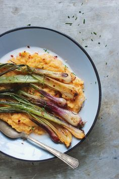 Red Curry Roasted Spring Onions with Creamy Coconut Polenta