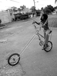 Chick with big hair on a chopper bike. 1970's.