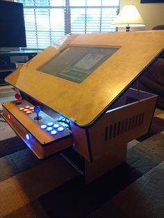 Retro arcade game coffee table made by one of our members! Great for any game room man cave ultimate DIY gaming console living room decor made with a CNC router
