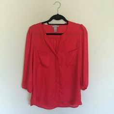 Red button up blouse 3/4 sleeves, hidden button up front. 2 front pockets. H&M Tops Button Down Shirts