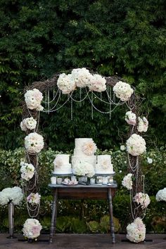 Rustic Romantic Arch of Flowers Twigs and Beads Over Cake Table...