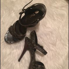 Snakeskin heels. Green and black snakeskin stilettos. The heel spears dark wooden. The insole is very cushiony. Two Lips Shoes Heels