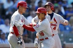 Jon Jay celebrates his three-run home run with Allen Craig and Yadier Molina during the seventh inning..Cards won the game 6-1  8-18-13