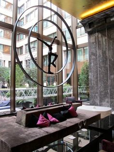Sculptures can create interest, in front of windows - the light makes it come alive.  Mandarin Oriental   Paris