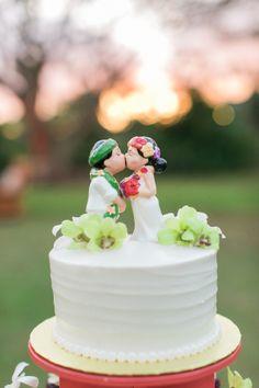 Cute Hawaiian cake toppers: http://www.stylemepretty.com/destination-weddings/2015/08/26/tropical-colorful-wedding-in-kauai-botanical-garden/ | Photography: Heather Cook Elliott - http://heathercookelliott.com/