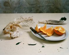 Still Life with Fish and Orange Slices from the series Vanitas - Conceptual Photography by Artist Justine Reyes