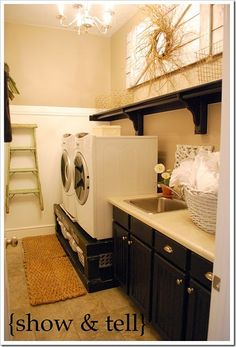 Another beautiful laundry room. Second time I've seen that raised platform for the washer/dryer.