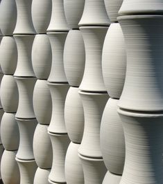 Japanese stoneware wall screens and dimensional elements by Kowa American.