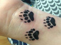 bear paw tattoo.     this will be on me one day, along with bear's brand.