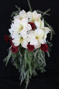 Having a winter or Christmas wedding? This strikingly festive wedding bouquet will be a beautiful addition to your wedding. This cascading bridal bouquet features long bushy, snowy greenery with white