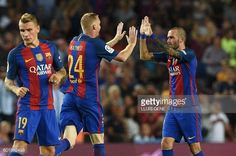 Barcelona's French defender Jeremy Mathieu celebrates a goal with Barcelona's…