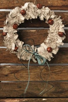 Rustic Christmas Wreath...made from burlap or muslin strips & rusty jingle bells.