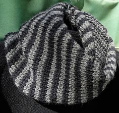 Striped cowl is handknit of bulky superwash 100% merino wool. Striped in chunky…