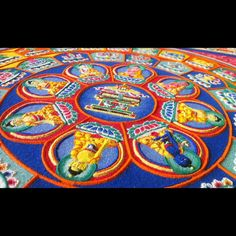 Tibetan Monks Painstakingly Create Incredible Mandalas Using Millions of Grains of Sand To promote healing and world peace, a group of Tibetan Buddhist monks, from the Drepung Loseling Monastery in. Sand Painting, Sand Art, Buddhist Monk, Tibetan Buddhism, Mandala Design, Mandala Art, Tibetan Mandala, Spiritual Symbols, Colored Sand