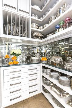 Pantry storage galore with thick glass countertops and mirror