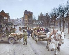 Ardennes Offensive 1944 - 45 A group of refugees make their way through the war torn city of Bastogne, Belgium where elements of the 101st Airborne Division remain. (photo taken 30 Dec 1944)