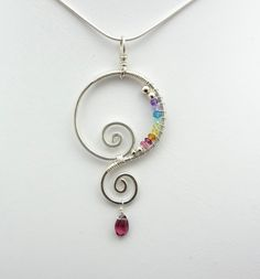 Rainbow Chakra Spiral Wire Wrapped Pendant. $48.00, via Etsy.