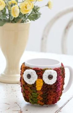 Owl Mug Wrap Crochet Pattern-What a hoot! Dress up a mug with this crocheted cozy—you'll feel all the wiser using it to sip your warm beverages. Makes a great gift for friends, teachers, Dads and all ages!