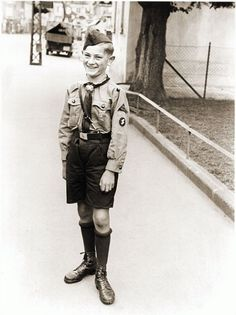 A Hitler Youth poses for a photograph in the Rhineland city of Bruehl, 1934. In 1939, membership in Nazi youth groups became mandatory for all boys and girls between the ages of ten and eighteen.