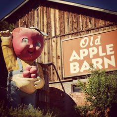 The Apple Boy welcomes visitors at Old Apple Barn, just fifteen minutes east of Edgington Garden RV Park.