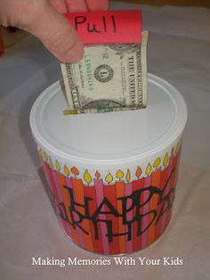 What a cute way to give money as a gift!  Cover a can with cute paper and then make a tab.  Tape dollar bills together and tac the tab to the first dollar bill and make sure the tab sticks out through the cut in the lid.  Now roll the dollar bills up. Stuff tissue paper in the canister as well for some cushion.  What kid wouldn't love this???  Adults, too!