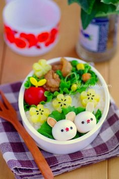 Bunny Bento: Bunny: quail eggs, nori, sliced almonds (on lettuce on rice) - Flowers: fried potatoes - Sides: sauteed mixed vegetables, fried pork, tomatoes, beans and sprouts