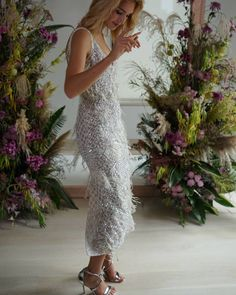 Switching it up a bit with the a column dress with a deep plunging v-neckline and scattered silver fringes Rehearsal Dinner Dresses, Rehearsal Dinners, Column Dress, Fringes, Formal Dresses, Wedding Dresses, Lace Skirt, Bridal Shower, White Dress