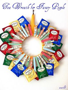 Tea wreath holds little tea packets in clothes pins. I need to make this for Janna, STAT.