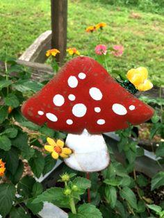 Mushroom stake in a container of lantana www.Gardenchick.com