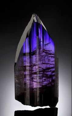 "Tanzanite - Measures: 4 1/8"" x 1 7/8"" x 3/4"" Estimate: $ 300,000-$ 350,000"