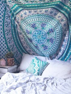 Top off your bed or accent a wall with this unique boho tapestry, featuring a beautiful turquoise and green mandala pattern on soft white fabric. This tapestry also doubles as a picnic blanket, perfec (Boho Top India)