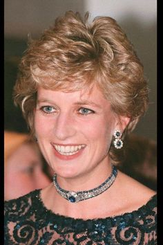 Princess Diana's Jewelry DOUBLE CLUSTER SAPPHIRE DROP EARRINGS. The top sapphire is surrounded by 10 diamonds and the bottom sapphire is surrounded by 11 diamonds. Note that the diamond outline of the bottom drop has a teardrop shape.