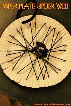 Stick the spider in the web. Use a hole punch to make a hole on the edge of the plate & use a piece of string or a pipe cleaner to hang your web.