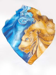 Lion scarf is a small square scarves hand painted on silk using amazing Setasilk Italian paints. This Art Nouveau pocket scarf is ready to go! The Lion and Ice Queen scarves is a square scarf hand painted with to opposite colors: yellow and blue. It is designed in a way that lets you choose the dominant color: you can wear it as a Ice Queen blue scarf or fiery gold and yellow scarf with lions head. This square scarf is quite small: it is approximately 22 x 22 inches (55 x 55 cm) in size…