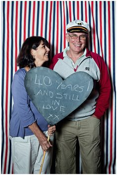 """""""Photo Booth"""" with chalkboard heart for guests to write notes to the bride and groom. <3"""