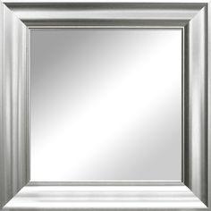 Spegel med silver- eller guldfärgad ram.