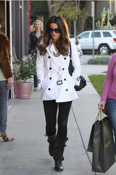 White double breasted short Burberry trench, leggings, and Frye biker boots. Kate Beckinsale is fabulous.